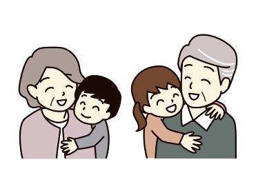 孫に抱きつかれる老夫婦