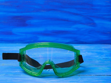 Plastic safety goggles on blue background, Moscow, Moscow, Russia