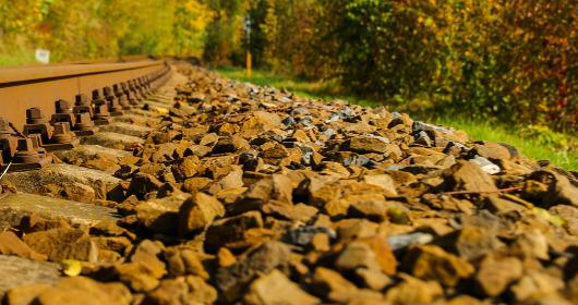 A close-up view of the large screws securing the train tracks , Czechia, Zlin Region, Valasske Mezirici