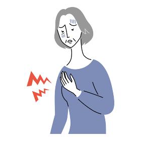 心臓が痛む様子のシニア女性