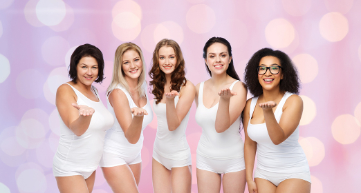 group of happy different women sending blow kiss