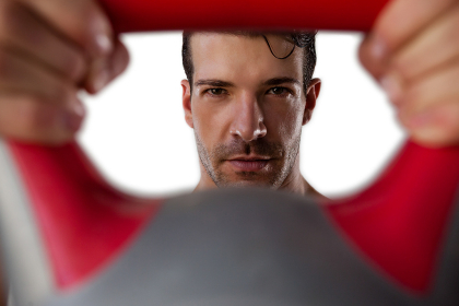 Portrait of sportsman exercising with kettle bell