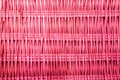 ピンク色の枝編み細工の背景素材