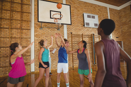 High school team scoring a goal while playing basketball