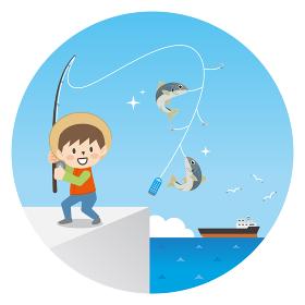 堤防でサビキ釣りをする男の子