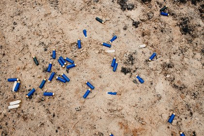 used ammunition cartridges on a soil. 12 mm. background