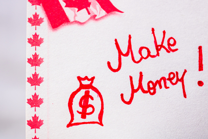 Make money handwriting on paper with Canada flag. Writing text on memo post reminder. Bucharest, Romania, 2020.