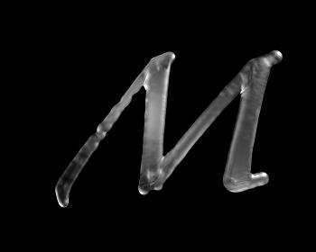 液体の文字 M