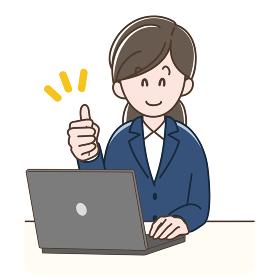 パソコンの前でグッドサインをするスーツの女性