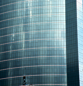 asia bangkok  thailand reflex of some blue palace skyscraper in a window    the centre