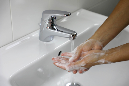 COVID-19 Washing hands with soap under the faucet with water against Novel coronavirus (2019-nCoV). Antiseptic, Hygiene and Healthcare concept.