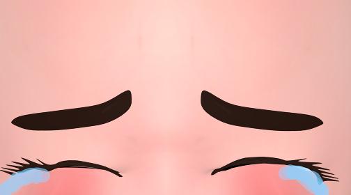 目を閉じて号泣する顔