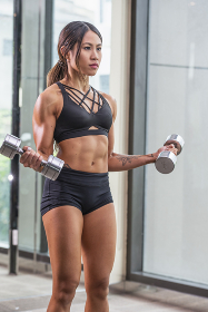 Young woman working out at private gym in Bangkok