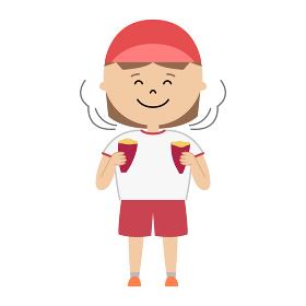 焼き芋を食べる女の子のイラスト (全身)
