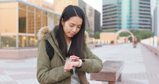 Woman use of smart watch for checking time