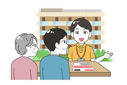 説明する男性介護士 祖母と息子 老人ホーム