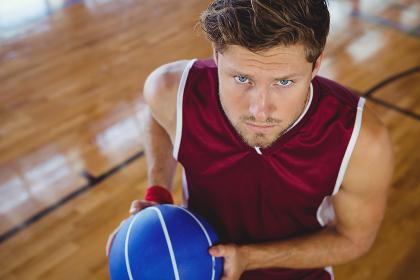 High angle portrait of basketball player holding ball