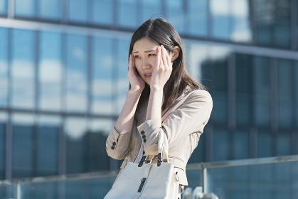 ストレスを感じるビジネスウーマン