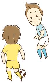 サッカーをする少年 一対一