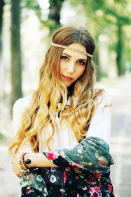 Fashion portrait of beautiful hippie young woman wearing boho chic clothes and summer hat outdoors. Soft warm vintage color tone. Artsy bohemian style.