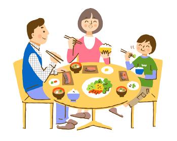 笑顔で朝食をとる3人家族