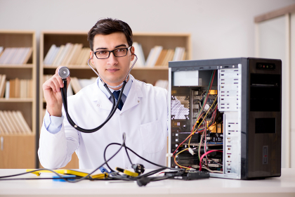 IT technician repairing broken pc desktop computer