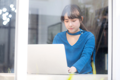 Beautiful portrait asia young woman working online on laptop sit