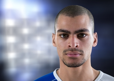 foreground of a soccer player with lights background