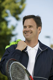Man with Tennis Racket and tennis balls