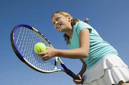 Young girl on tennis court Preparing to Serve low angle view close up