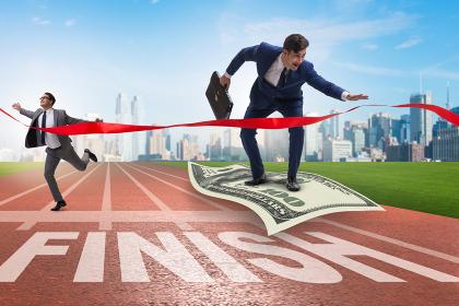 Businessman flying on dollar banknote towards finish line
