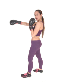 Slim woman in workout outfit boxing