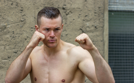athletic man doing boxing exercises