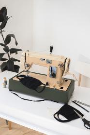 Vintage sewing machine the process of sewing a protective medical mask, Rivne, Rivne Oblast, Ukraine