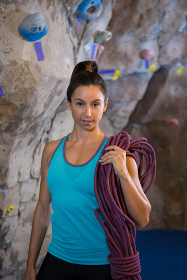 Woman holding rope in fitness studio