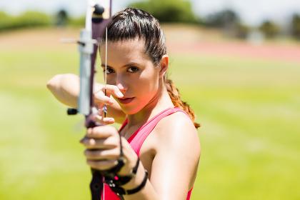 Female athlete practicing archery