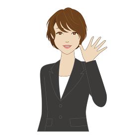 笑顔で手を振るスーツ姿の女性会社員