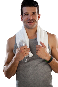 Portrait of smiling tired sportsman with towel and bottle