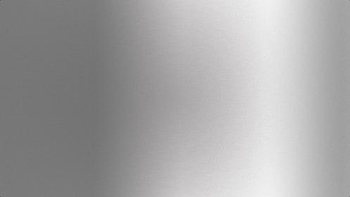 メタリックな質感を持つ銀色の背景。ステンレスやアルミを感じさせるシルバーの素材。