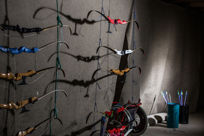 Bows and arrows in an indoor archery range - archery club