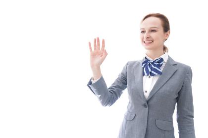 手をふる制服を着た留学生