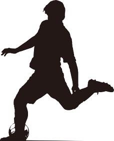 キックをするサッカー選手のシルエット