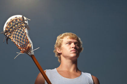 Lacrosse player with lacrosse stick