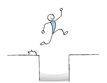 穴をジャンプする人物