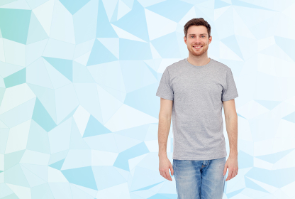 happy smiling young man in gray t-shirt and jeans