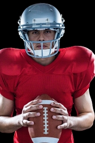 Portrait of determined sportsman with American football