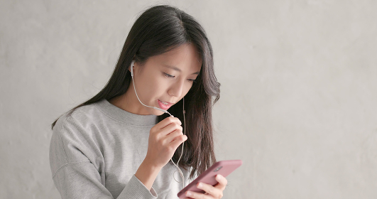 Woman talking on hand free with mobile phone