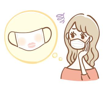 マスクに化粧が付いて悩む女性
