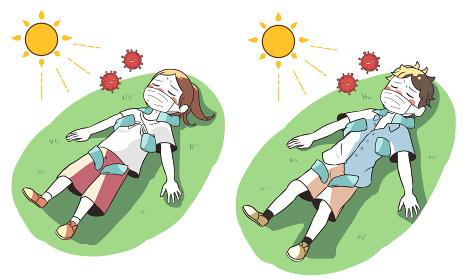 熱中症と新型コロナウイルスで倒れる 草の上