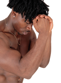 Close up of a black man flexing his muscles